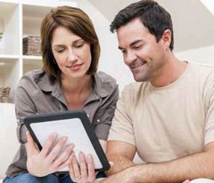 couple viewing responsive medical website on tablet