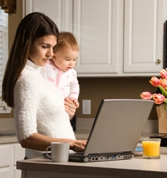 mother and sick child viewing pediatric website